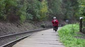 ferrovia : Two cute boys on railway, running on the platform, autumn time