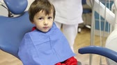 temor : Little child, boy, sitting on a dentist chair, having his yearly checkup