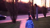 два человека : Happy family, father and two children, going home on sunset, walking near road