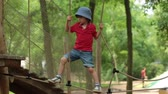 desafio : Cute child, boy, climbing in a rope playground structure, springtime Stock Footage