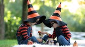 dia das bruxas : Two children, boy brothers in the park with Halloween costumes, having fun