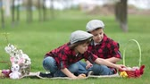 blooming : Two children, boy brothers, having fun with easter eggs in the park, beautiful spring blooming garden Stock Footage