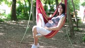 springtime : Young beautiful pregnant woman, relaxing in a hammock springtime