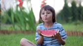 fruit slice : Happy little child, boy with watermelon in a garden, summertime