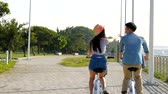 travel : happy young couple biking in the park