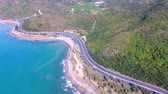 Aerial view of coast road and blue ocean Wideo