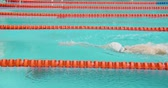 A Man Swimming In the Swimming Pool