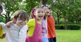 エレメンタリー : Multi-ethnic group of school children laughing and embracing