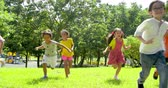 Multi-ethnic group of school children laughing and running Stockvideo