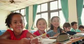 Smiling elementary school kids in classroom