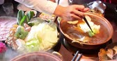 Sliced beef in the hot pot soup for Shabu Shabu Stock Footage
