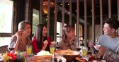 Happy young friends enjoy dinner in hot pot restaurant