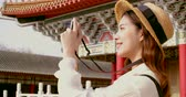 исследовать : asian female traveler photographing temples at Asia
