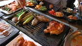 ateş : BBQ chicken and seafood on grill at restaurant Stok Video