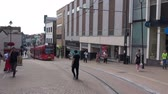 trough : A London Tram Passes Trough An Intersection.  Croydon, London, England - CIRCA July 2015: A London tram (Street Car) passes through an intersection in a pedestrian precinct, at Croydon, London, England, on CIRCA July 2015 Stock Footage