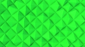 экран : rows of green pyramids slowly moving. abstract. 3d rendering