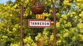 дорожный знак : Road sign of Tanneron, small town in Provence-Alpes-Côte dAzur, France. Part of Road of mimos Стоковые видеозаписи