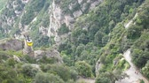 funicular : SPAIN, MONTSERRAT - SEPTEMBER 11: Video of Cable car ascending the mountain at Montserrat monastery on September 11, 2015