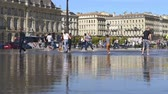 gironde : FRANCE, BORDEAUX - SEPTEMBER 20: People having fun in a mirror in the front of the Place de la Bourse in Bordeaux, France on September 20, 2015 Stock Footage