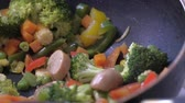 sacudindo : cooking fresh vegetable in a bowl, close up