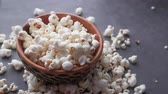 kanapé : Close up of popcorn in a bowl on table Stock mozgókép