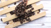 fundo de madeira : top view of coffee beans on spoon on table Vídeos