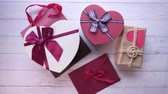 noel kartı : top view of heart shape gift box on white background