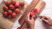 top view of man hand cutting tomato on chopping board Stock mozgókép