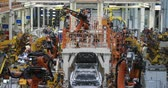 robô : Assembly line production of new car. Automated welding of car body on production line. robotic arm on car production line is working Stock Footage