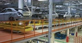 çıktısı : body of car on conveyor Modern Assembly of cars at plant. automated build process of car body. Stok Video