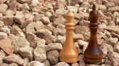 checkmate : Black and white chess on stones Stock Footage