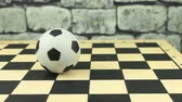 checkmate : Soccerball souvenir on a chessboard