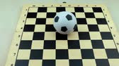 отставка : Soccerball on a chessboard Стоковые видеозаписи