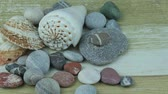 useful resources : Color river stones on wooden background Stock Footage