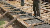 шланг : Work On The Construction Site To Pour The Foundation Concrete Under Pressure