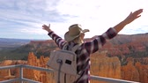 pináculo : Woman Raised Hands Upwards While Standing On Observation Deck Overlooking Canyon