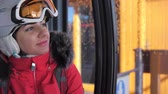 funicular : Close-up Smiling lovely Woman Skier Rises Sitting In Ski Lift Cable Car Stock Footage
