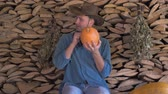 checks : Man Farmer Checks The Ripeness Of The Pumpkin And At The End Thumb Up Stock Footage