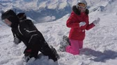 dodge : In The Mountains Resort A Cheerful Pair Of Skiers Playing Snowballs Stock Footage