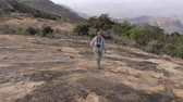 planalto : Woman Hiking On A Stone Plateau On A Cooled Lava To The Top Of A Dormant Volcano