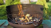 fogueira : Beautifully Burn Fire In Barbecue On The Green Lawn In Yard On Summer Evening Vídeos