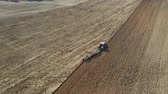 arando : Agricultural Tractor With Plow Plowing The Field Before Planting Aerial View