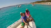 sister : Young happy family with two little girls on a big boat during sammer vacation in Italy Stock Footage