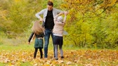 3 : Happy family in autumn park outdoors