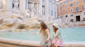 roma : Adorable little girls on the edge of Fountain of Trevi in Rome. Happy kids enjoy their european vacation in Italy