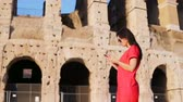coliseum : Young woman in front of Colosseum with smart phone in hands in Rome, Italy. Girl in Europe vacation