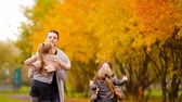 four children : Family with little kids in autumn park enjoy warm day Stock Footage