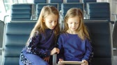 boarding pass : Little adorable girls in airport near big window
