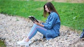 literatura : Relaxed young woman reading book