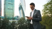 abogado : Young caucasian man holding smartphone for business work.